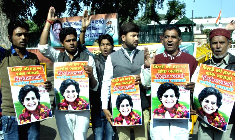 Congress workers demand Priyanka Gandhi to take the leadership of the party in New Delhi, on Feb 10, 2015.