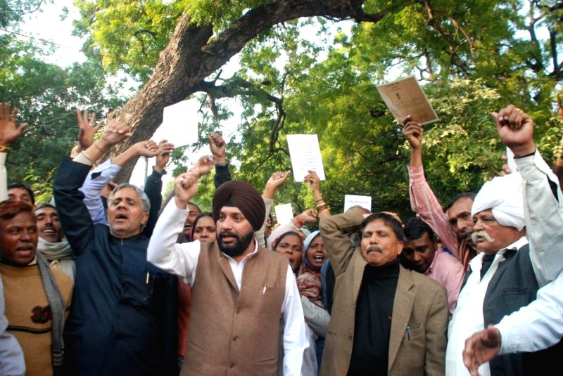 Congress workers led by Delhi Congress chief Arvinder Singh Lovely in New Delhi on Dec 15, 2014. - Arvinder Singh Lovely