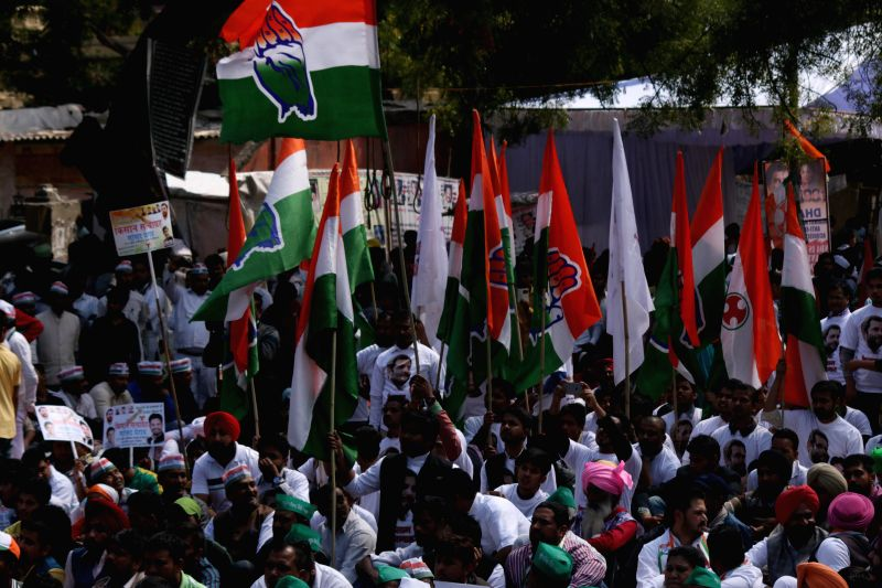 Congress workers participate in a demonstration against the Land Acquisition Bill at Jantar Mantar in New Delhi, on March 16, 2015.