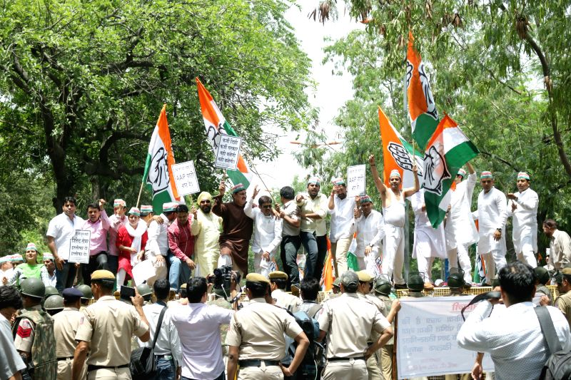 Congress workers protest against Delhi government demanding resignation of Delhi Law Minister Jitender Singh Tomar in New Delhi on April 30, 2015. - Jitender Singh Tomar