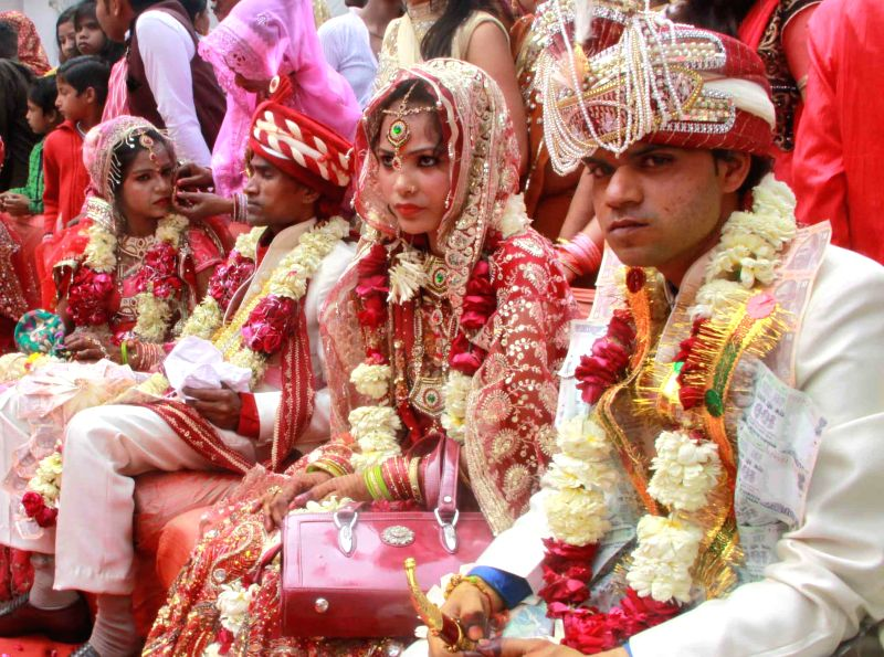 Couples at a mass marriage programme organised in New Delhi on Feb 20, 2015.