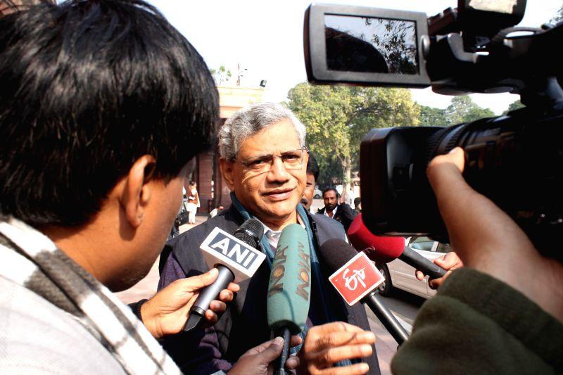 CPI(M) leader and MP Sitaram Yechury talks to press at the Parliament premises in New Delhi, on Dec 16, 2014. - Sitaram Yechury