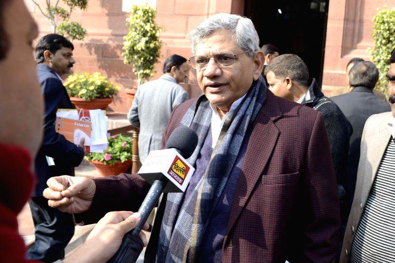 CPI (M) leader and MP Sitaram Yechury talks to press at the Parliament premises in New Delhi, on Dec 17, 2014. - Sitaram Yechury
