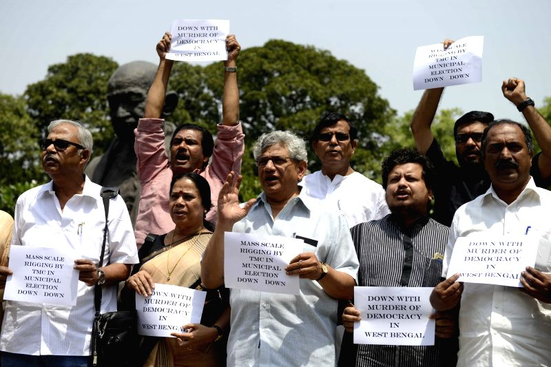 CPI-M MPs Sitaram Yechury, Mohammed Salim, Ritabrata Banerjee and others stage a demonstration against irregularities during West Bengal civic polls at the Parliament in New Delhi, on ... - Sitaram Yechury and Ritabrata Banerjee