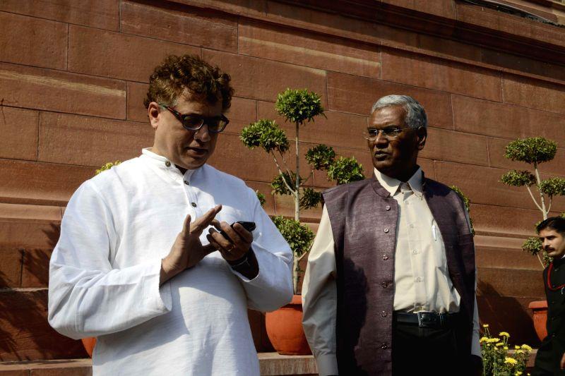 CPI MP D Raja and TMC MP Derek O'Brien at the Parliament premises in New Delhi, on Nov 25, 2014.