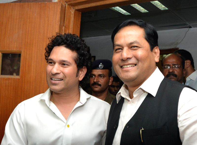 Cricket legend and MP Sachin Tendulkar calls on Union MoS for Sports Sarbananda Sonowal in New Delhi on Nov 26, 2014.
