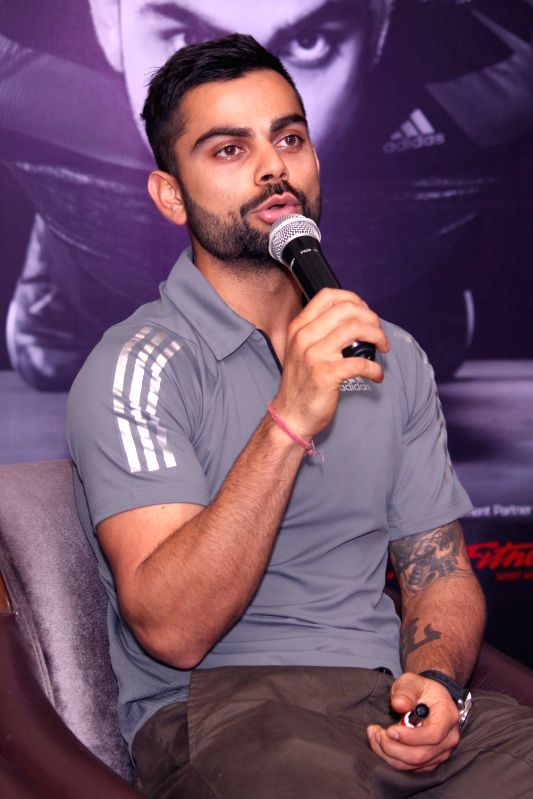 Cricketer Virat Kohli at the launch of a fitness club in New Delhi, on April 25, 2015. - Virat Kohli