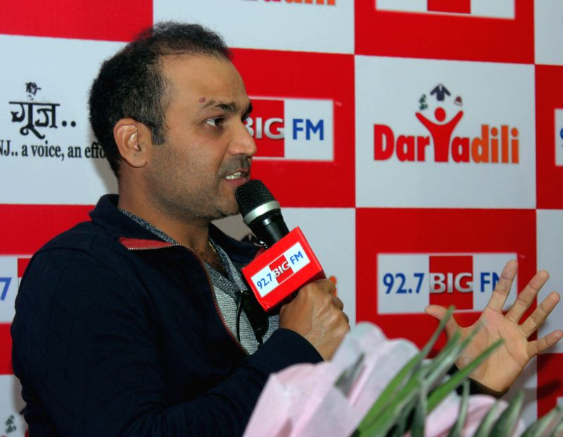 Cricketer Virender Sehwag addresses during a philanthropic programme organised by 92.7 BIG FM and Goonj - a NGO in New Delhi on Dec 12, 2014.
