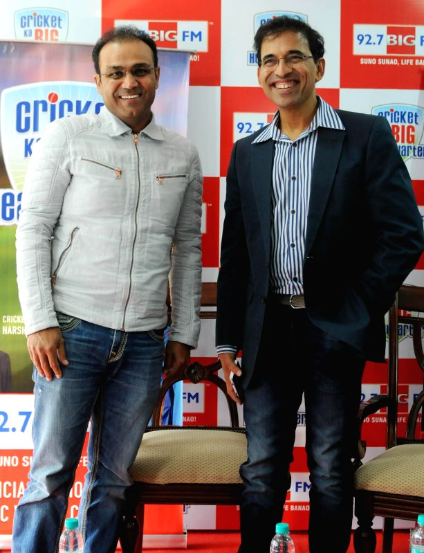 Cricketer Virender Sehwag with commentator Harsha Bhogle during the launch of a special cricket show in New Delhi on Feb. 2, 2015.