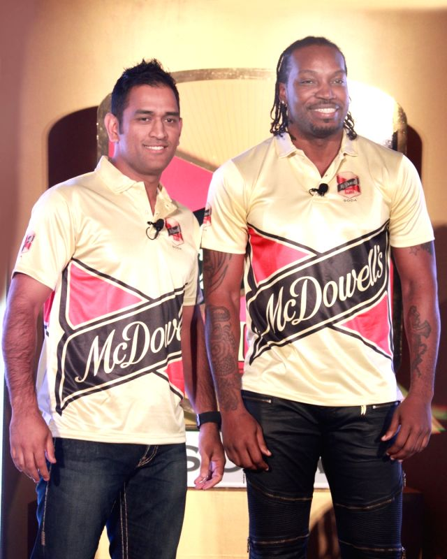 :New Delhi:  Cricketers Mahendra Singh Dhoni and Chris Gayle during a promotional programme in New Delhi, on Nov 2, 2015. . - Mahendra Singh Dhoni