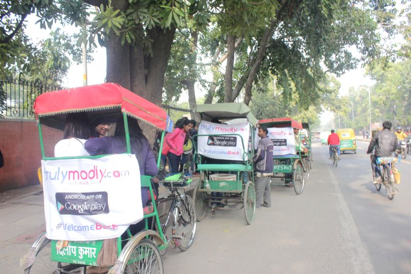 Cycle-rickshaws ply with the banners of a dating app that was launched at the North campus of Delhi University in New Delhi on Jan. 6, 2014.