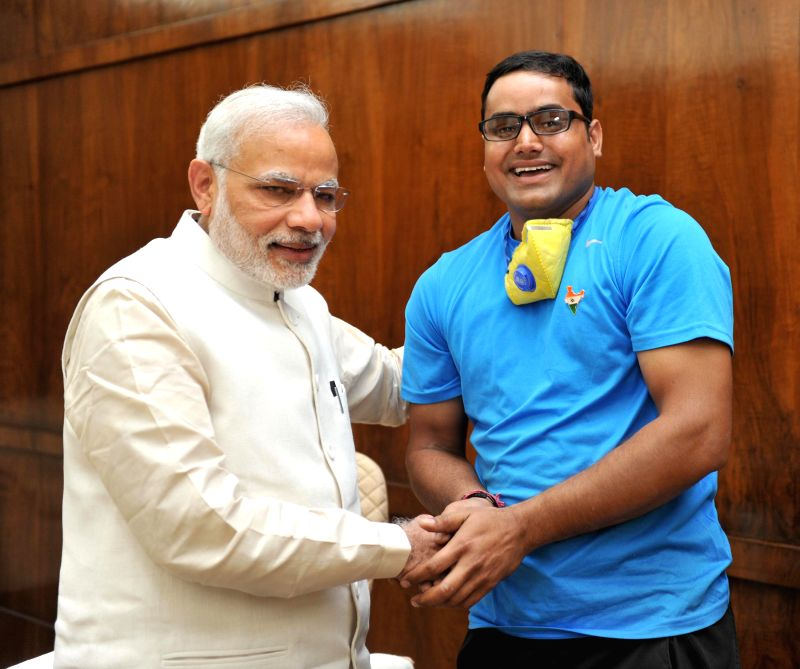 Cyclist Abhishek Kumar Sharma, who is undertaking the nationwide `Swachh Bharat` awareness cycle yatra calls on the Prime Minister Narendra Modi, in New Delhi on March 16, 2015. - Narendra Modi