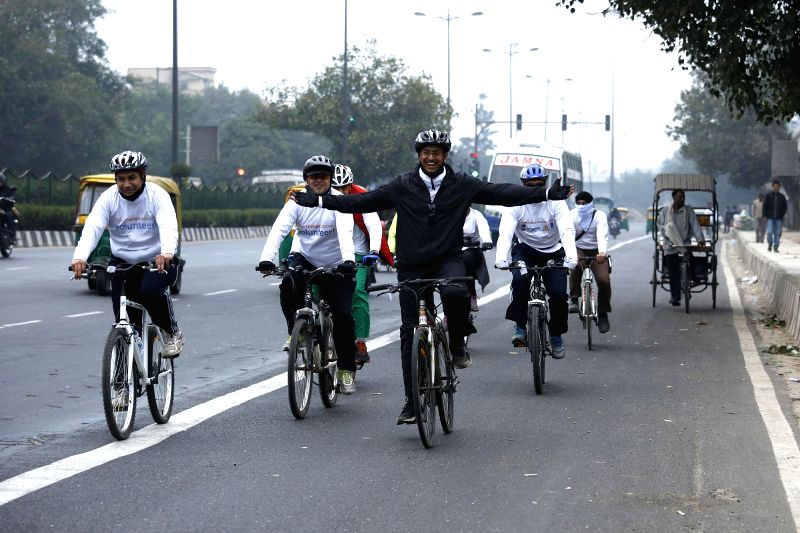 Cyclists participate in a 16 km cyclothon around New Delhi to draw attention towards the need to clean-up the Yamuna river on Dec 14, 2014.