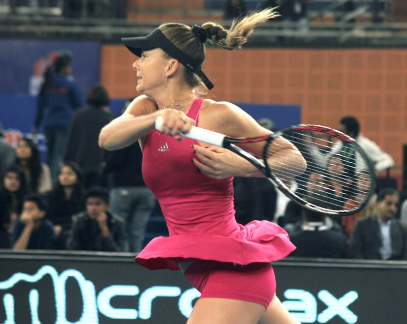 Daniela Hantuchova of Singapore Slammers in action during an IPTL women's singles match against Ana Ivanovic of Indian Aces at Indira Gandhi Indoor Arena in New Delhi, on Dec 7, 2014. ...