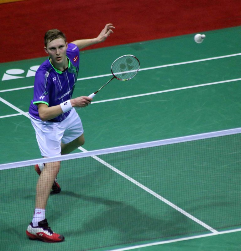 Danish badminton player Viktor Axelsen returns a shot to his Indian counterpart Srikanth Kidambi during a match of Indian Open Badminton Championship in New Delhi on March 29, 2015.