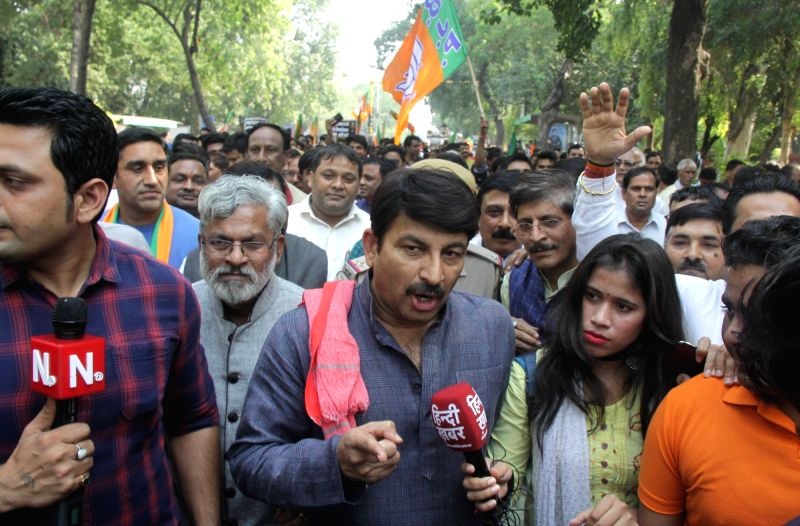 New Delhi: Delhi BJP chief Manoj Tiwari talks to the media during the party's protest outside AAP office, demanding an apology from Delhi Chief Minister Arvind Kejriwal over his remarks on the Rafale verdict, two days after the Supreme Court dismisse