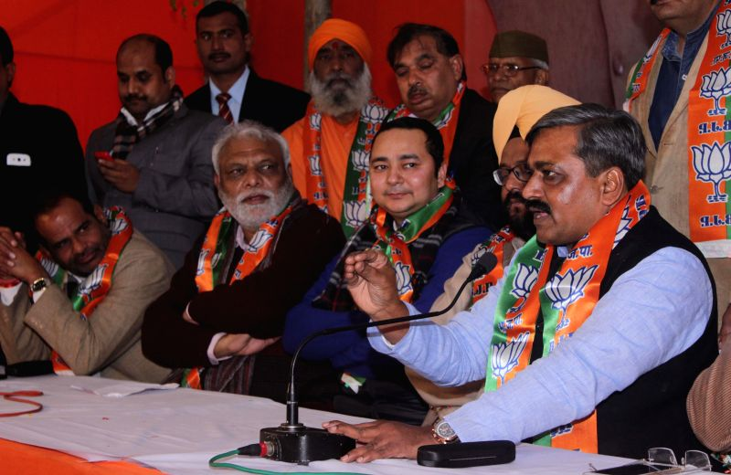 Delhi BJP chief Satish Upadhyay addresses during a programme organised to welcome the new party members in New Delhi, on Jan 13, 2015.