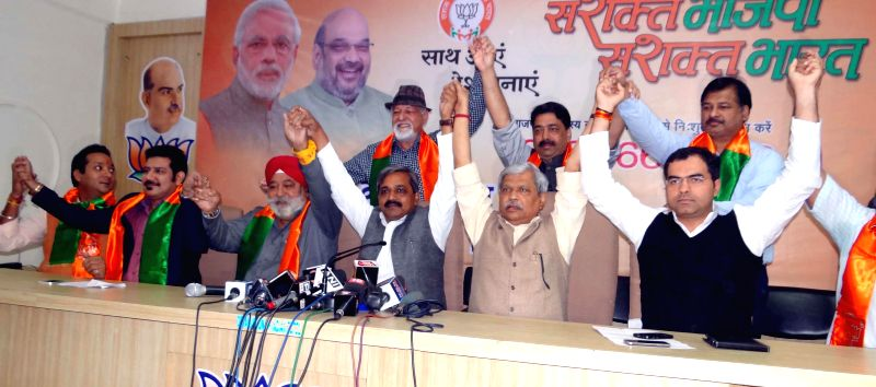 Delhi BJP chief Satish Upadhyay and other party leaders during a press conference in New Delhi on Nov 25, 2014. - Satish Upadhyay