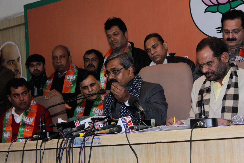 Delhi BJP chief Satish Upadhyay and BJP MP Ramesh Bidhuri during a press conference in New Delhi, on Jan 8, 2015. - Satish Upadhyay