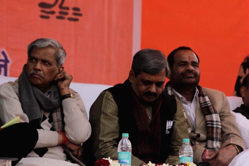 Delhi BJP chief Satish Upadhyay, Delhi in-charge of BJP Prabhat Jha and South Delhi MP Ramesh Bidhuri during a party rally in New Delhi, on Jan 25, 2015.  - Satish Upadhyay