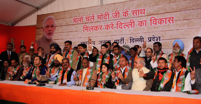 Delhi BJP chief Satish Upadhyay during a programme organised to welcome the new party members  in New Delhi, on Jan 13, 2015.