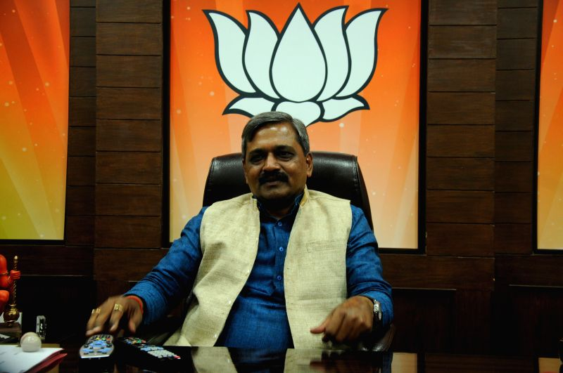Delhi BJP chief  Satish Upadhyay keeps track of news on the day of counting for the  recently concluded Delhi Assembly polls at party office in New Delhi, on Feb 10, 2015. (Photo: IANS) e - Satish Upadhyay