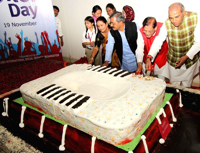 Delhi BJP chief Satish Upadhyay, Sulabh International Founder Bindeshwar Pathak and others cut a 700 kg cake on World Toilet Day in New Delhi, on Nov 19, 2014.