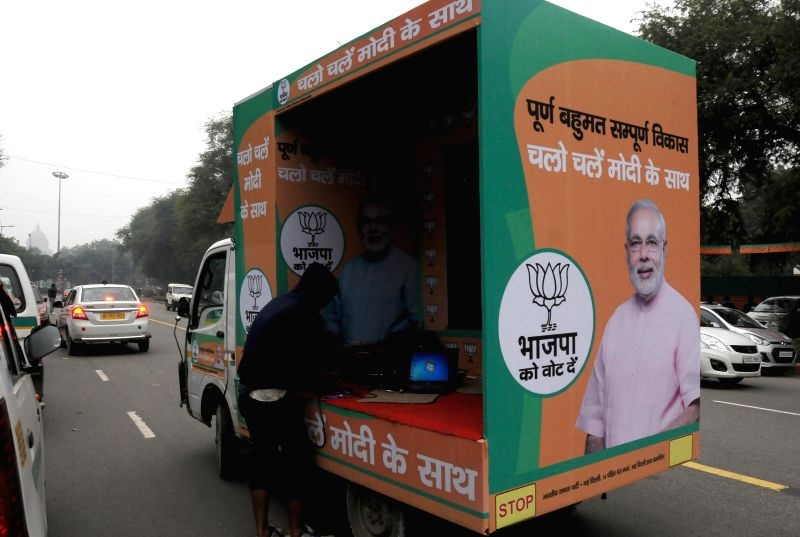 Delhi BJP launches 3D Rath as part of their campaign for the upcoming Delhi Assembly Election at BJP party office in New Delhi on Jan. 3, 2014.