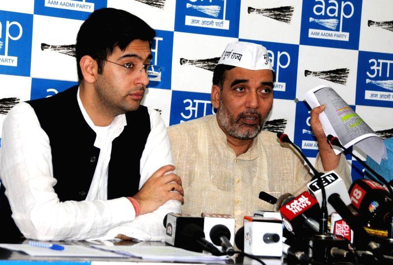 New Delhi: Delhi Cabinet Minister Gopal Rai accompanied by AAP leader Raghav Chadha, addresses a press conference in New Delhi, on April 19, 2019.