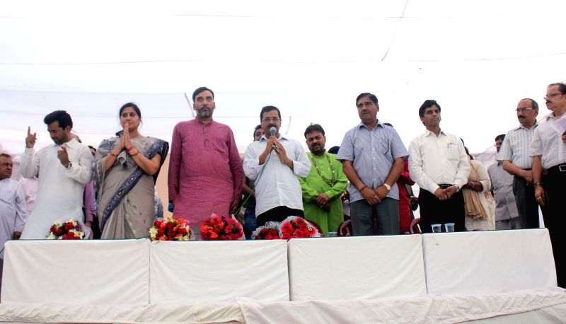 Delhi Chief Minister and AAP leader Arvind Kejriwal and others during a May Day programme organised at Shalimar Bagh of Delhi on May 1, 2015. Also seen Delhi Transport Minister Gopal Rai. - Gopal Rai and Arvind Kejriwal