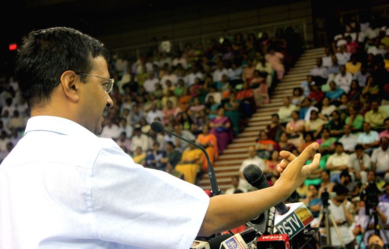 Delhi Chief Minister and AAP leader Arvind Kejriwal addresses during an interactive session with Government School Principals at Thyagaraj Stadium in New Delhi on May 2, 2015. - Arvind Kejriwal