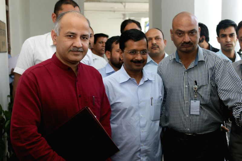 Delhi Chief Minister Arvind Kejriawal and Deputy Chief Minister Manish Sisodia arrive at the Delhi assembly to attend the budget session of the assembly in New Delhi, on March 24, 2015. - Arvind Kejriawal