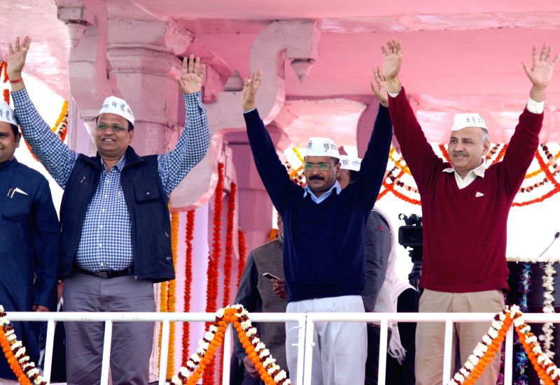Delhi Chief Minister Arvind Kejriwal and Aam Aadmi Party (AAP) leaders Manish Sisodia and Satyendra Jain during oath taking ceremony of Kejriwal at Ramlila Maidan in New Delhi, on Feb 14, . - Arvind Kejriwal and Satyendra Jain