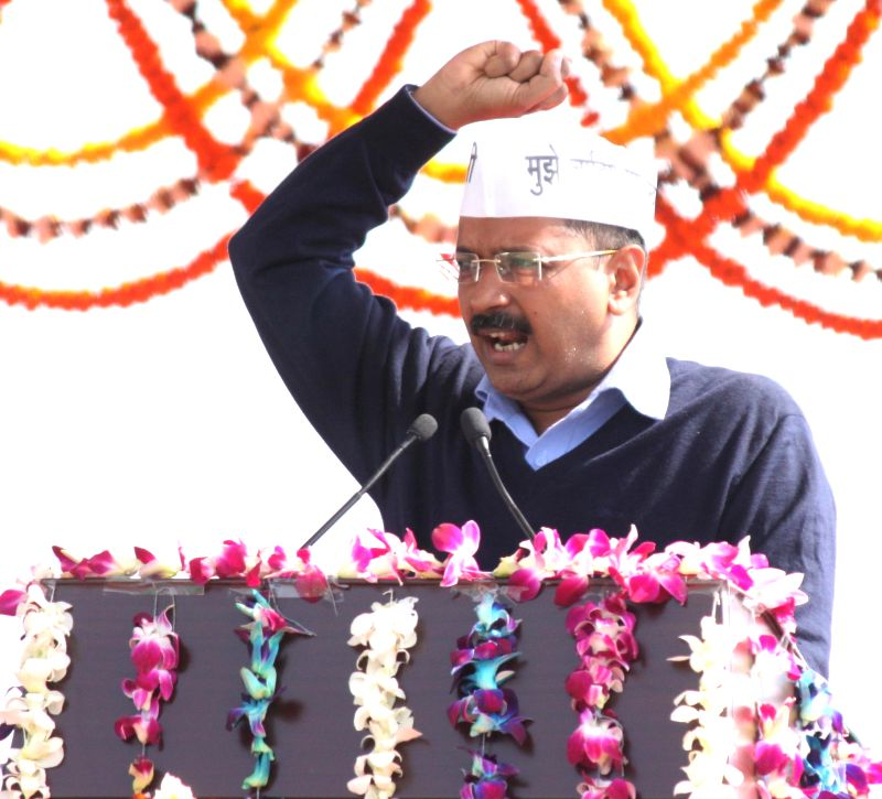 Delhi Chief Minister Arvind Kejriwal addresses public after taking oath at Ramlila Maidan in New Delhi, on Feb 14, 2015. - Arvind Kejriwal