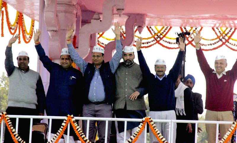 Delhi Chief Minister Arvind Kejriwal and Aam Aadmi Party (AAP) leaders Manish Sisodia, Gopal Rai, Satyendra Jain and others during oath taking ceremony of Kejriwal at Ramlila Maidan in New - Arvind Kejriwal, Gopal Rai and Satyendra Jain