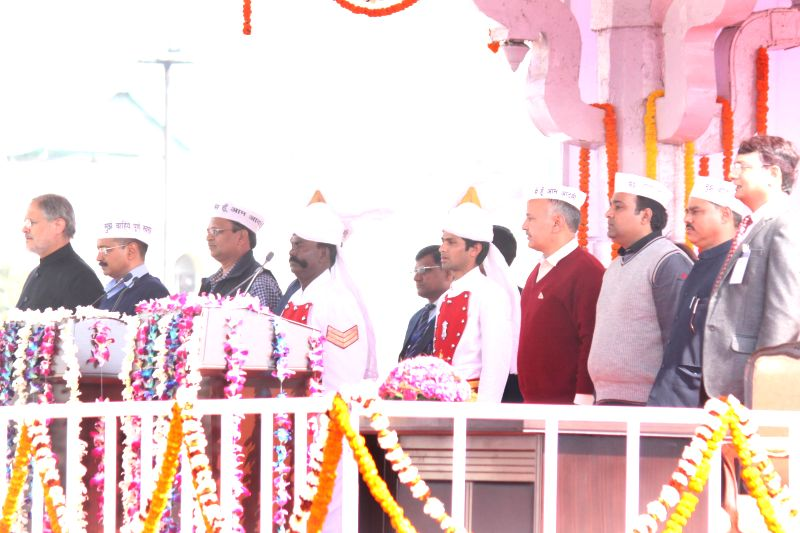 Delhi Chief Minister Arvind Kejriwal, Delhi Lieutenant Governor Najeeb Jung and Aam Aadmi Party (AAP) leader Manish Sisodia during the swearing-in ceremony of Delhi Chief Minister Arvind .. - Arvind Kejriwal