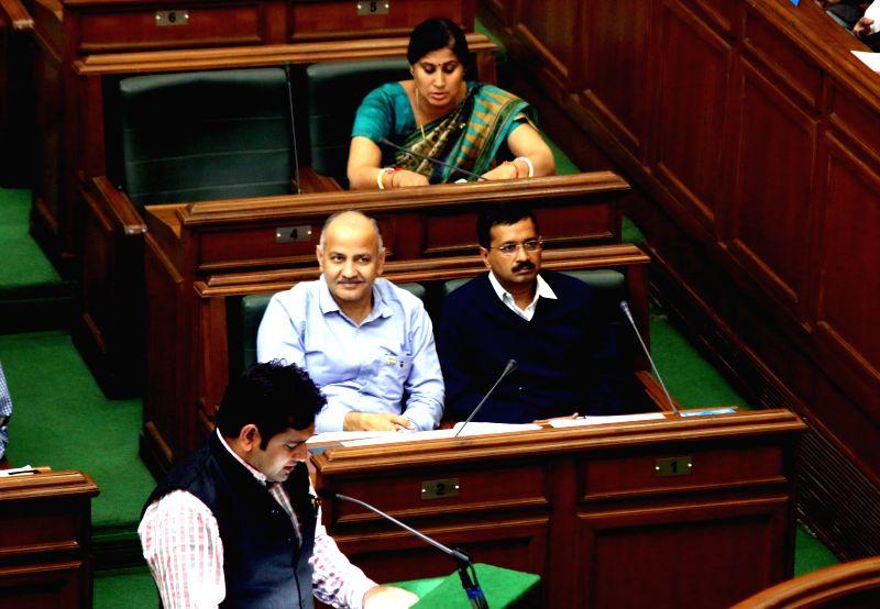 Delhi Chief Minister Arvind Kejriwal and Deputy Chief Minister Manish Sisodia during a Delhi Legislative Assembly session in New Delhi, on Feb 23, 2015. - Arvind Kejriwal