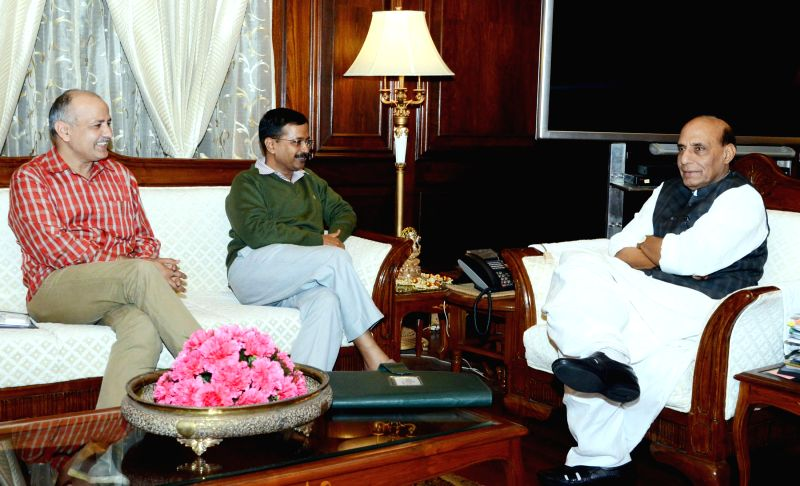 Delhi Chief Minister Arvind Kejriwal calls on the Union Home Minister Rajnath Singh, in New Delhi on Feb 26, 2015. Also seen Delhi Deputy Chief Minister Manish Sisodia. - Arvind Kejriwal
