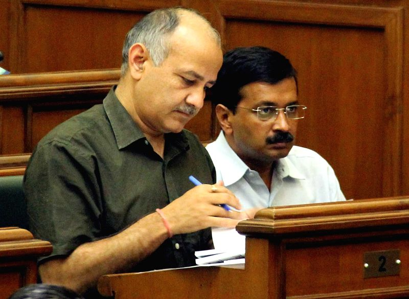 Delhi Chief Minister Arvind Kejriwal and Deputy Chief Minister Manish Sisodia during the budget session of the assembly in New Delhi, on March 25, 2015. - Arvind Kejriwal