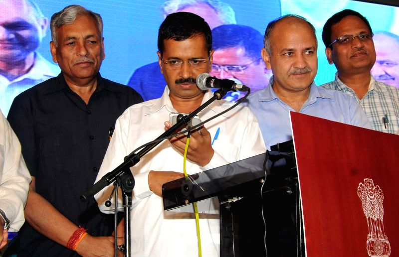 Delhi Chief Minister Arvind Kejriwal with Deputy Chief Minister Manish Sisodia and Delhi Assembly Speaker Ram Niwas Goel at the launch of an anti-corruption helpline at Talkatora Stadium ... - Arvind Kejriwal
