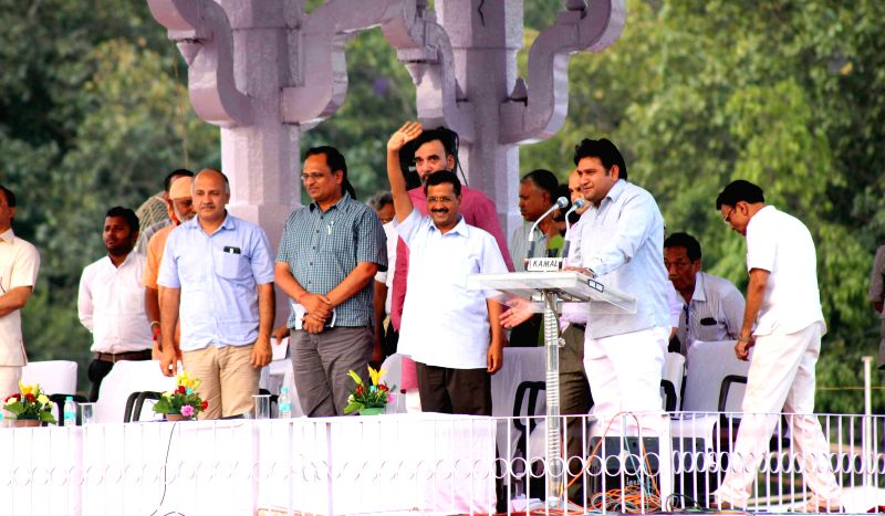 Delhi Chief Minister Arvind Kejriwal during a meeting with sanitation workers at Ramlila Maida in New Delhi, on June 8, 2015. Also seen Delhi Deputy Chief Minister Manish Sisodia, Health ... - Arvind Kejriwal, Satyendra Jain and Gopal Rai
