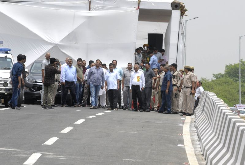 New Delhi: Delhi Chief Minister Arvind Kejriwal and Public Works Department Minister Satyendra Kumar Jain arrive to inaugurate the newly constructed Rao Tula Ram (RTR) Flyover at Outer Ring Road near Munirka in New Delhi, on July 16, 2019. (Photo: IA