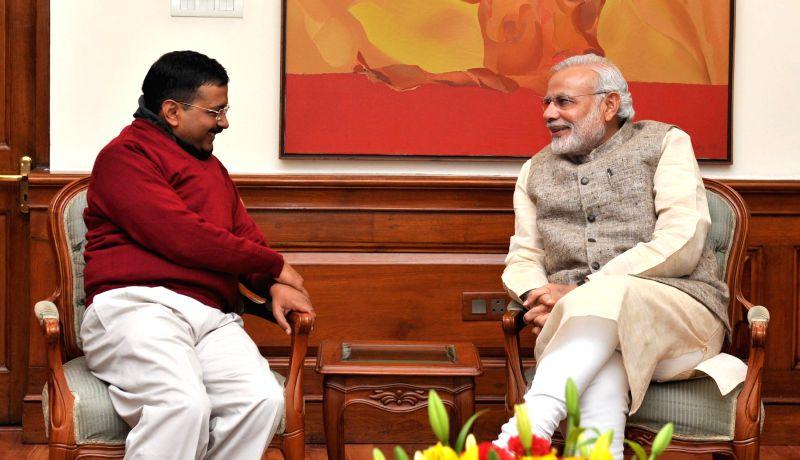 Delhi Chief Minister-designate Arvind Kejriwal calls on the Prime Minister Narendra Modi, in New Delhi on Feb 12, 2015. - Narendra Modi