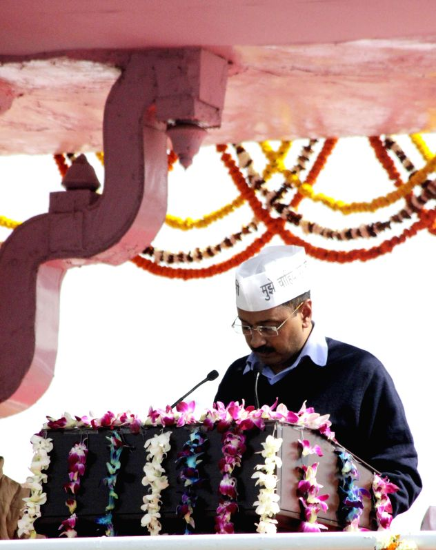 Delhi Chief Minister - designate Arvind Kejriwal takes oath at Ramlila Maidan in New Delhi, on Feb 14, 2015. - Arvind Kejriwal