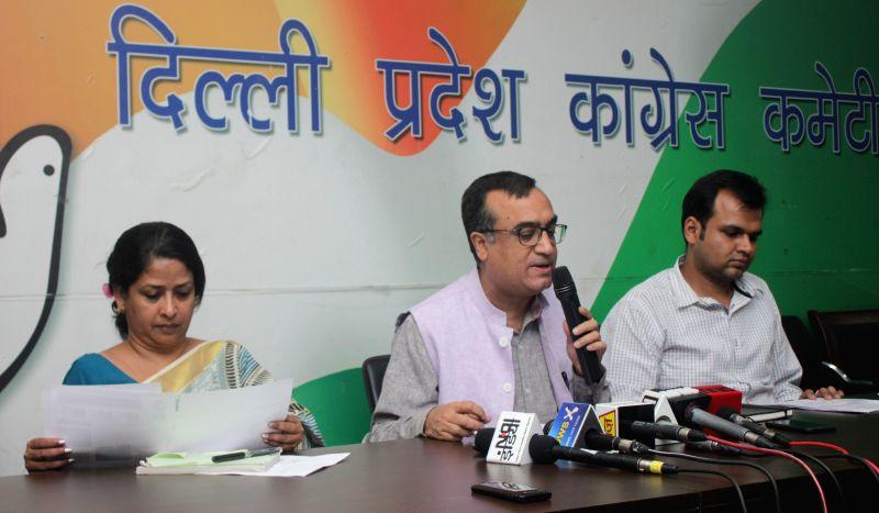 Delhi Congress chief Ajay Maken addresses during a press conference in New Delhi, on April 20, 2015. Also seen Delhi Congress spokesperson Sharmistha Mukherjee.