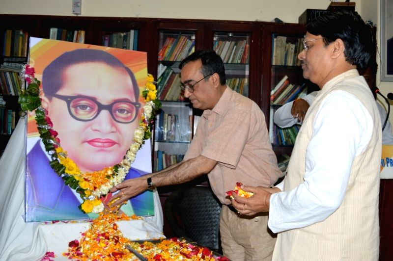 Delhi Congress chief Ajay Maken pays tribute to Dr. B.R. Ambedkar on his birth anniversary in New Delhi on April 14, 2015.