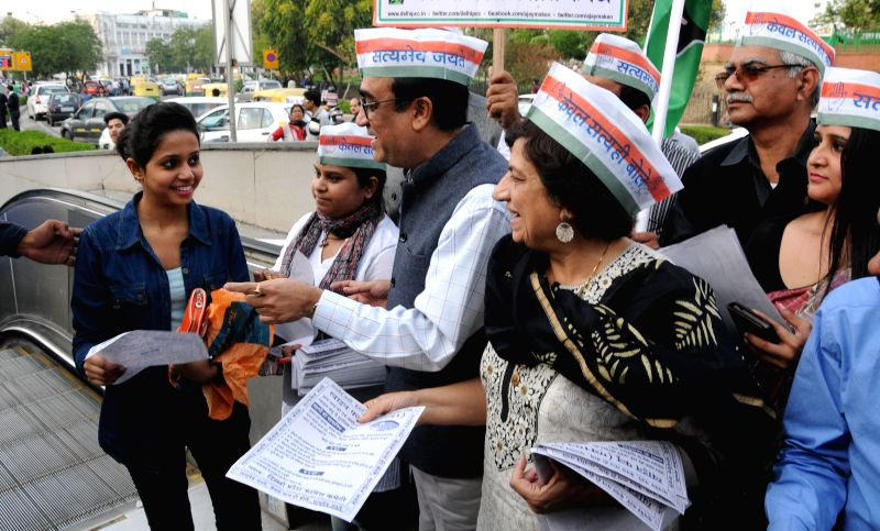 Delhi Congress chief Ajay Maken with Kiran Walia and other party leaders during a swine flu awareness campaign in New Delhi on March 11, 2015.