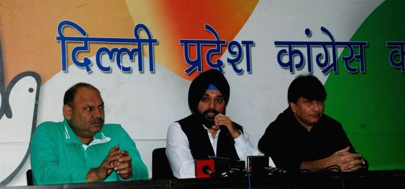 Delhi Congress chief Arvinder Singh Lovely addresses a press conference in New Delhi on Nov 28, 2014. Also seen Congress leader Haroon Yusuf and Mukesh Sharma. - Arvinder Singh Lovely and Mukesh Sharma
