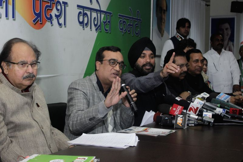 Delhi Congress chief Arvinder Singh Lovely, party's campaign panel chief Ajay Maken and others at the launch of party's manifesto for upcoming Delhi assembly polls in New Delhi, on Jan 23, - Arvinder Singh Lovely
