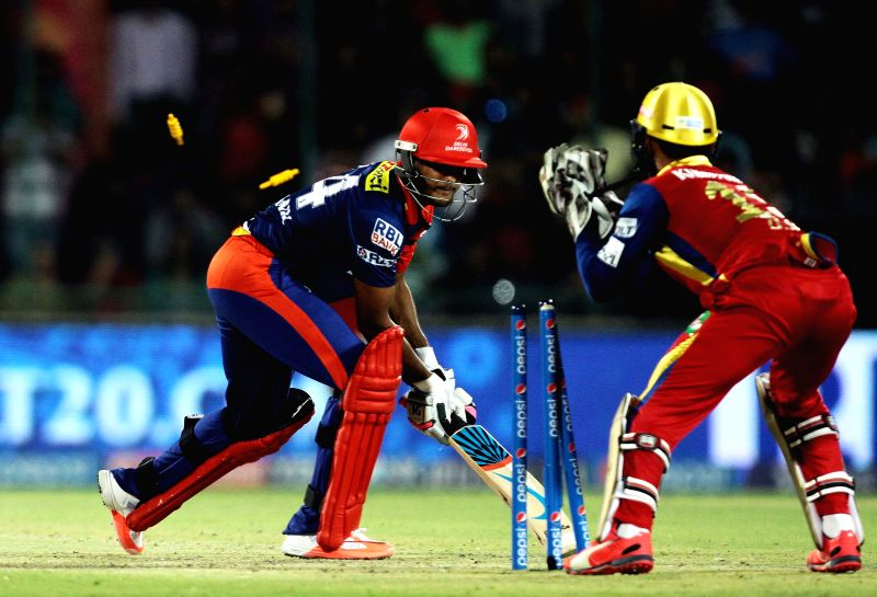 Delhi Daredevils batsman Mayank Agarwal gets dismissed by Dinesh Karthik during an IPL -2015 match between Delhi Daredevils and Royal Challengers Bangalore at Feroz Shah Kotla stadium  in ... - Mayank Agarwal and Feroz Shah Kotla